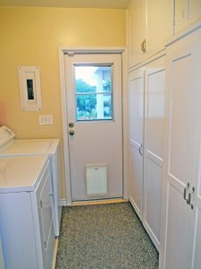 Look at all of the cabinetry in this amazing laundry room!