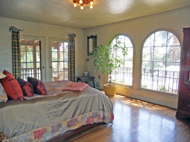 Alternate view of master bedroom. Unbelievable as it may seem, but those arched windows actually OPEN to enable you to hear the local song birds, enjoy a fresh breeze, or water the lovely balcony plants!