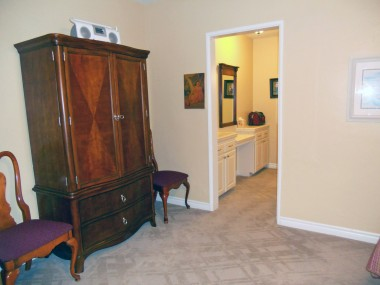 Alternate view of master bedroom with doorway leading to changing area, walk-in closet and private remodeled bathroom!