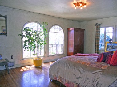 Enormous master bedroom with walk-in closet, access to two separate balconies, and overlooking the peaceful backyard!