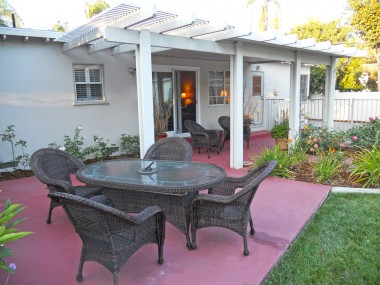 Alternate view of lovely covered patio -- all outdoor furniture for sale as well.