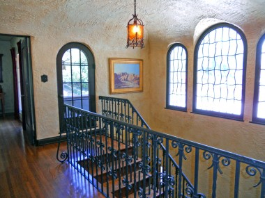 Alternate view of 2nd floor stairway with arched doorway to step-out balcony. Next photo is view from that balcony.