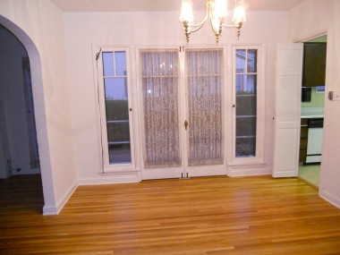 Formal dining room with French doors and gorgeous hardwood floors.
