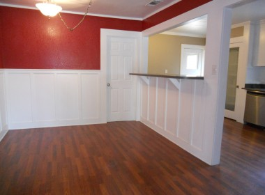 Formal dining room with brand new light fixture, pass-through to kitchen, and doorway to bonus room.