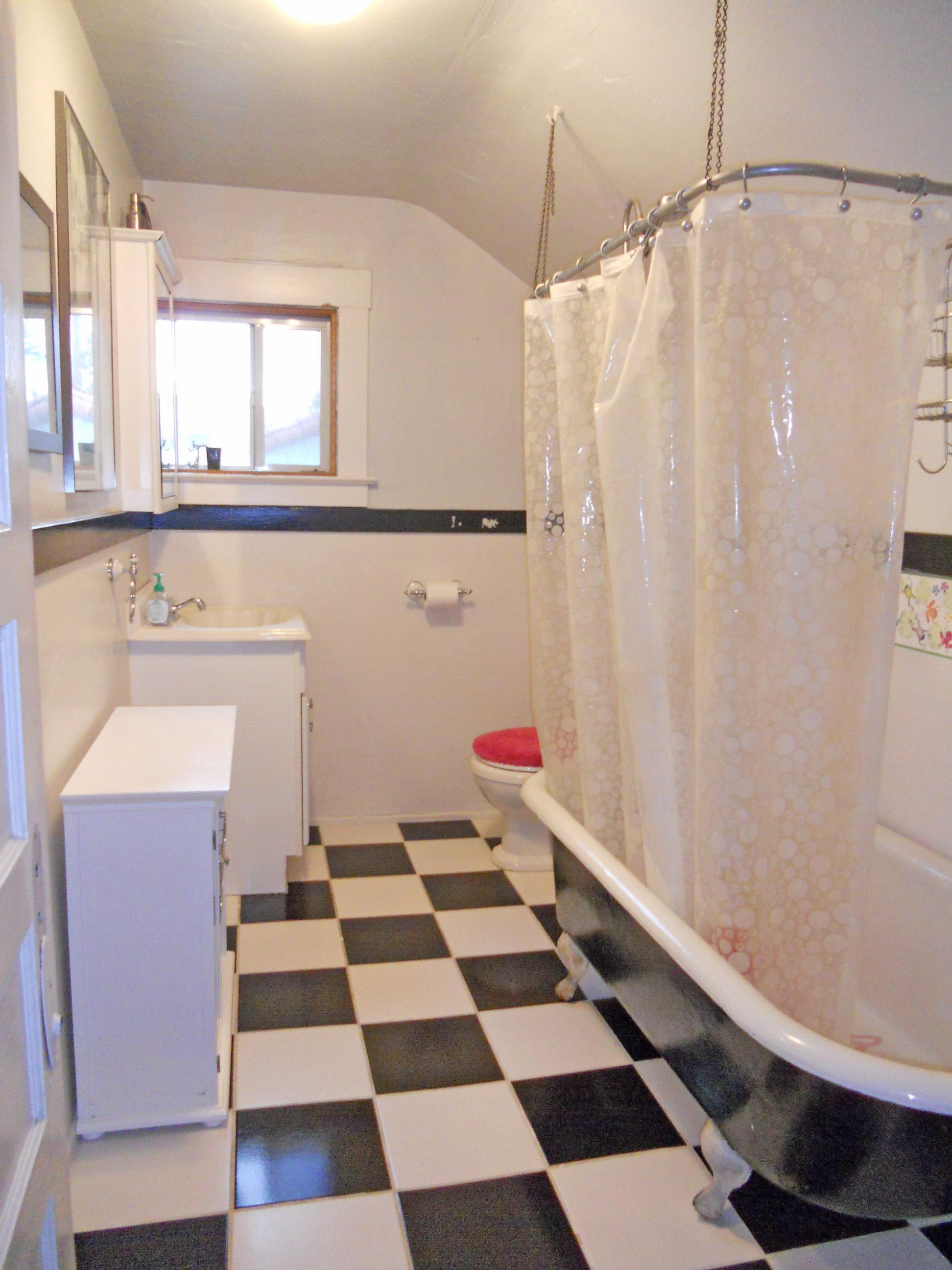 Upstairs bathroom with clawfoot tub.