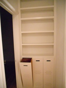 Custom hallway shelves and pull-out drawers.