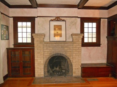 Original hardwood floors and stone fireplace flanked by storage seat and built-in display niche, and gorgeous lighted coffered ceiling too!