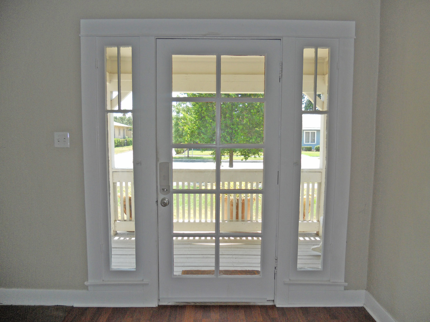 Charming front door overlooking covered front porch.