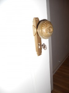 Many original door knobs with attached skeleton keys.