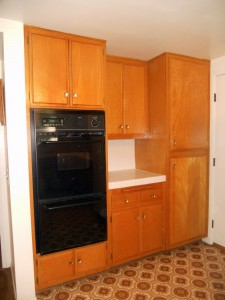 Double oven on back wall of kitchen, with loads of storage!!!