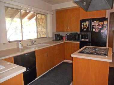 Updated kitchen with Corian-like counters, tile floor, and an eat-in breakfast area with built-in hutch!