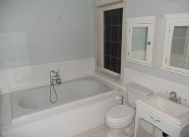 Soaking tub in the master bathroom with tile floor. And on the other side of the room there is an expansive walk-in tiled shower!
