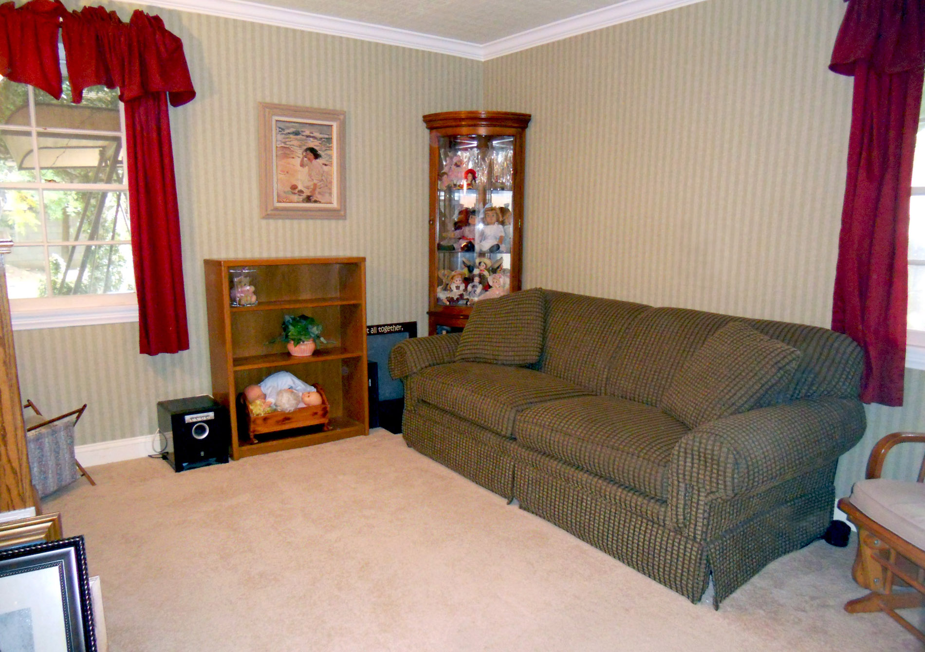 This bedroom (one of three all with carpet) has two closets, crown molding, and overlooks the beautiful backyard.