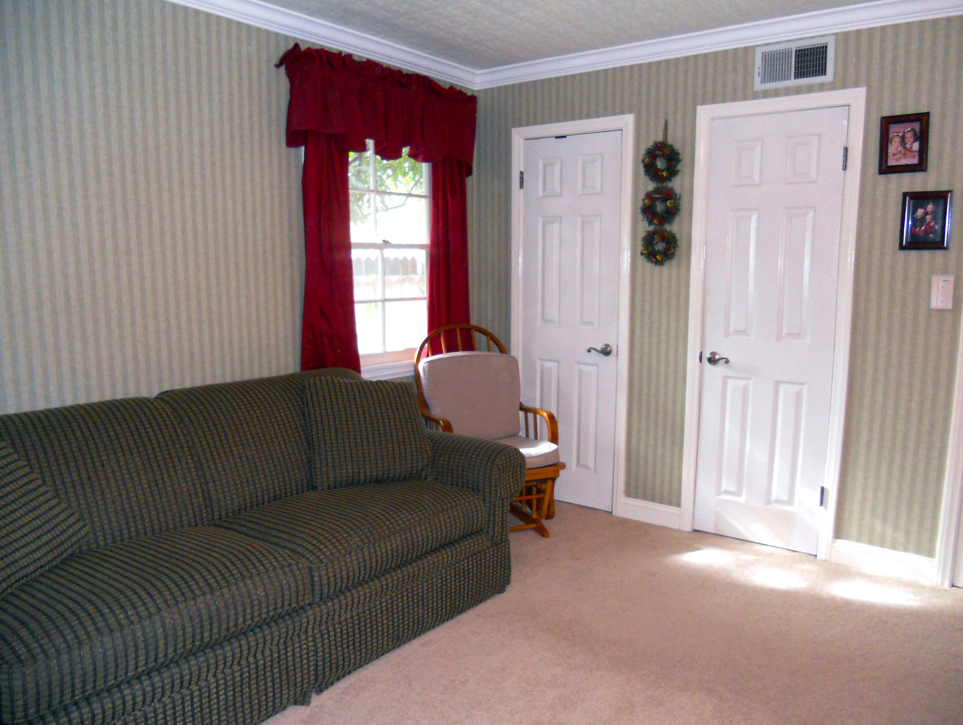 Alternate view of secondary bedroom with two closets, new doors and crown molding.