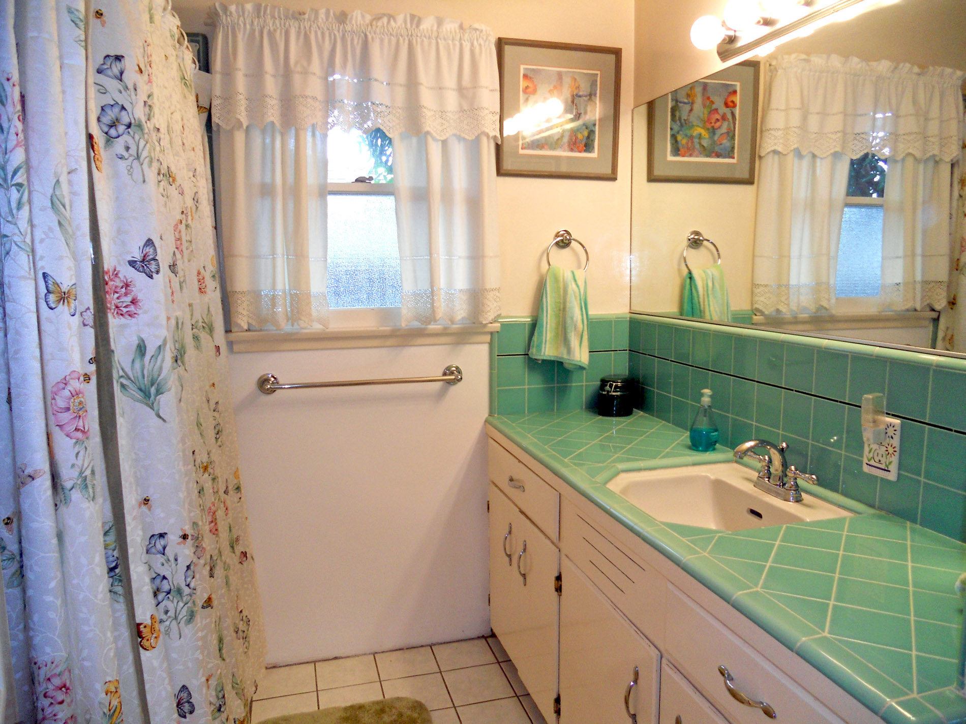 Second bathroom with original counter top tile in like-new condition. The tile in the tub/shower is like-new also!