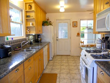 Remodeled kitchen with tile floor, granite counter tops, new cabinetry, dishwasher -- and refrigerator is included!