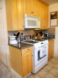Built-in microwave and gas stove, granite counter tops and new cabinetry.