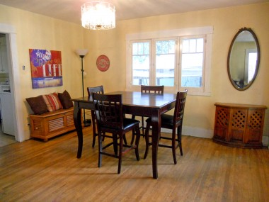 Formal dining area with hardwood floors and lots of natural light.