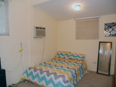 Bonus room with closet space and bathroom behind the garage.