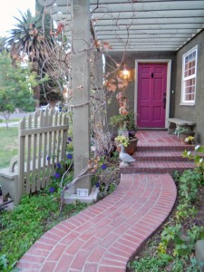 Talk about charming! Such a quaint and whimsical entry, complete with grapevine arbor and lovely flowers that will be in full bloom in a few weeks.
