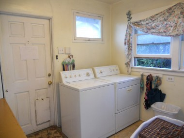 Indoor laundry room with access to backyard.