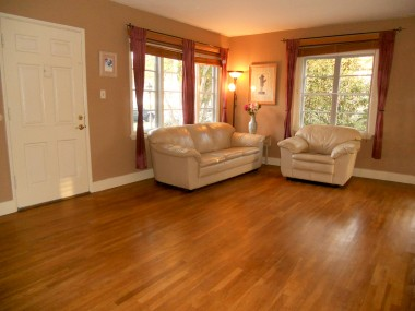 Living room with refinished original hardwood floors.