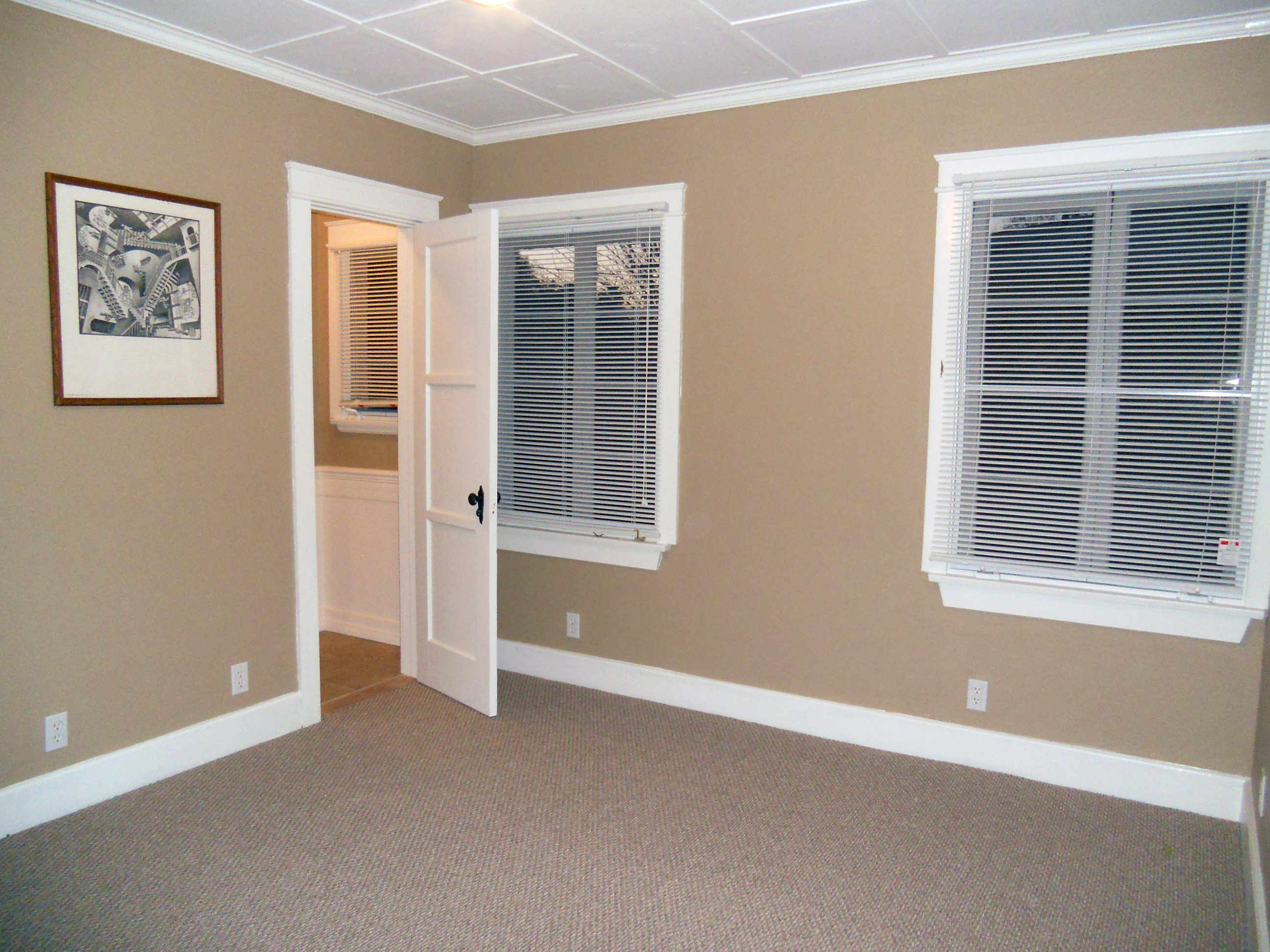 Popular Back bedroom with new carpet working wood windows new paint and a small