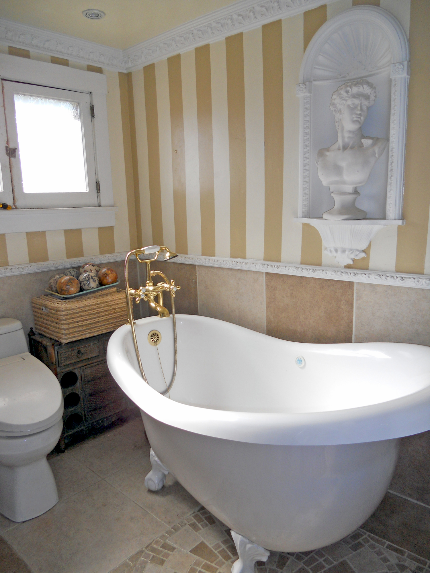 Beautiful Private bathroom for bedroom with tile floor and clawfoot spa tub