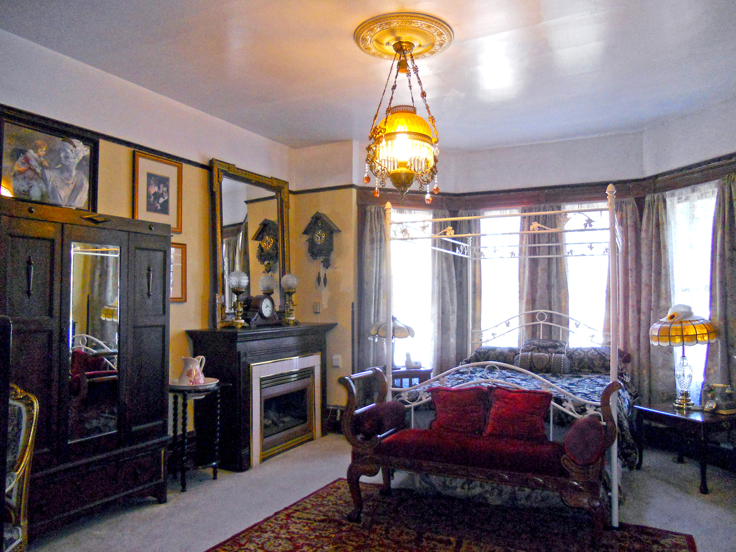 Marvelous Upstairs bedroom with bay window and vented fireplace that stays with the house
