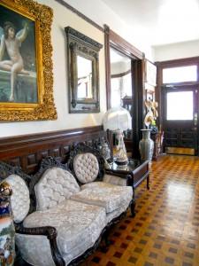 Alternate view of foyer (looking toward the front door). Note the original inlaid wood floor.