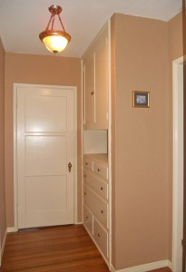 Hallway between the bedrooms (massive storage space for linens, etc.). Original ceiling light fixture.