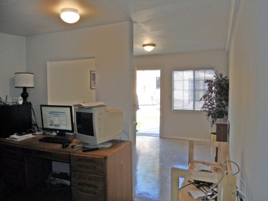 Alternate view of office from far back corner. Room is separated by a half wall with a pass through. Quite charming!