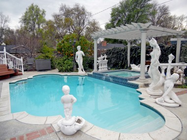 Inground pool and spa are only 15 years old. Yummy orange tree for fresh-squeezed juice while sitting pools-side! Statues are negotiable items.