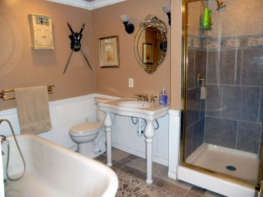 Alternate view of upstairs hallway bathroom with shower and pedestal sink.