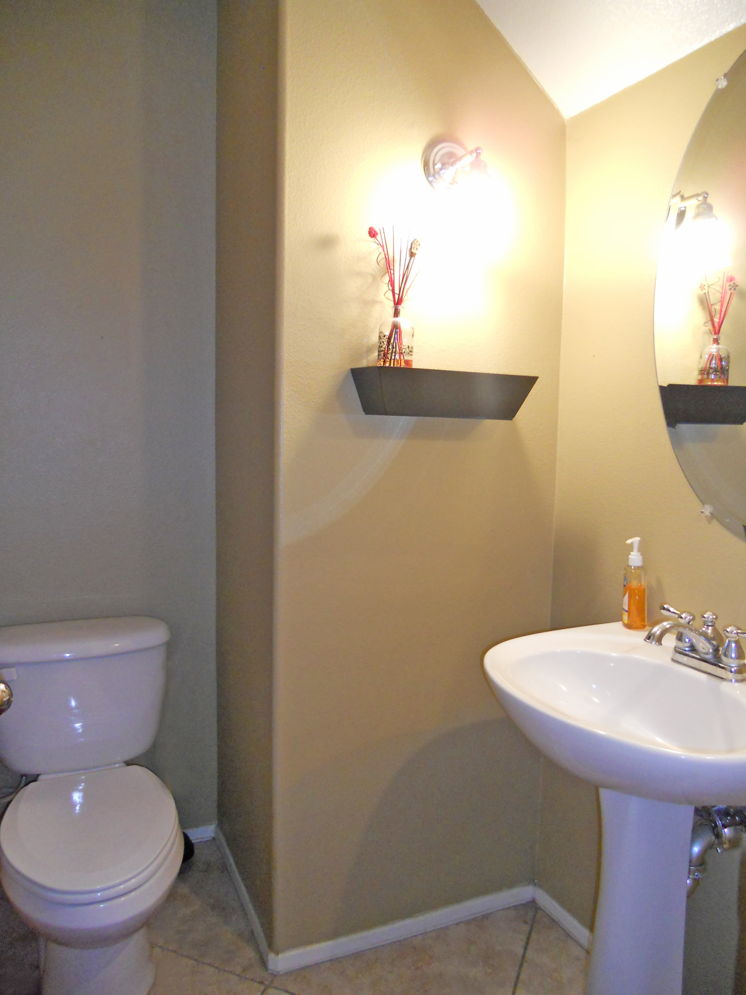 Great Convenient downstairs hall bath with tile floor and pedestal sink