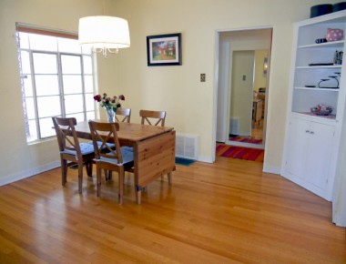 Formal dining room with built-in corner hutch.