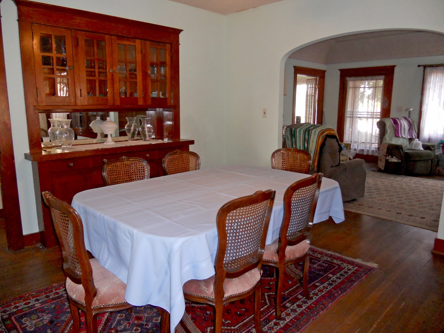 Formal dining room with original built-in hutch (never painted) and original hardwood floors.