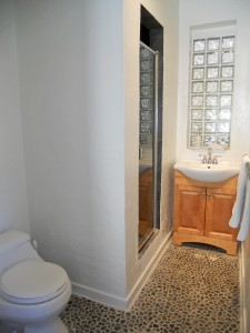 Remodeled 3/4 bathroom with unique stone floor.