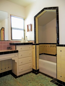 Original alcove bathtub, as well as a separate shower stall.