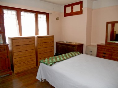 Middle bedroom is quite spacious, with an original built-in dresser inside closet, as well as a closet window to allow in lots of natural light.