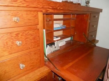 Original built-in desk next to fireplace.