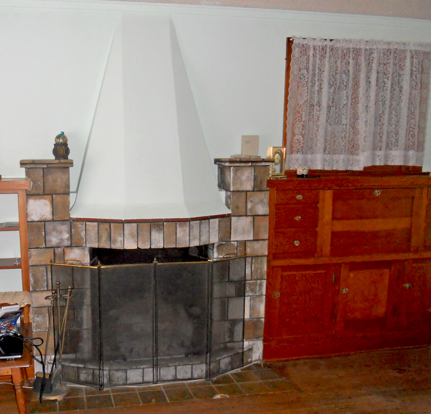 Very unique (and original) fireplace flanked by built-in desk and bookshelves.