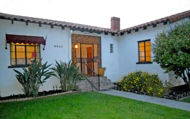 Elegant Spanish faacade complete with Spanish-tile roof and awning with wrought iron finials.