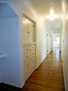 Lovely hallway with telephone alcove and deep linen closet, as well as another large walk-in closet at other end of hallway.