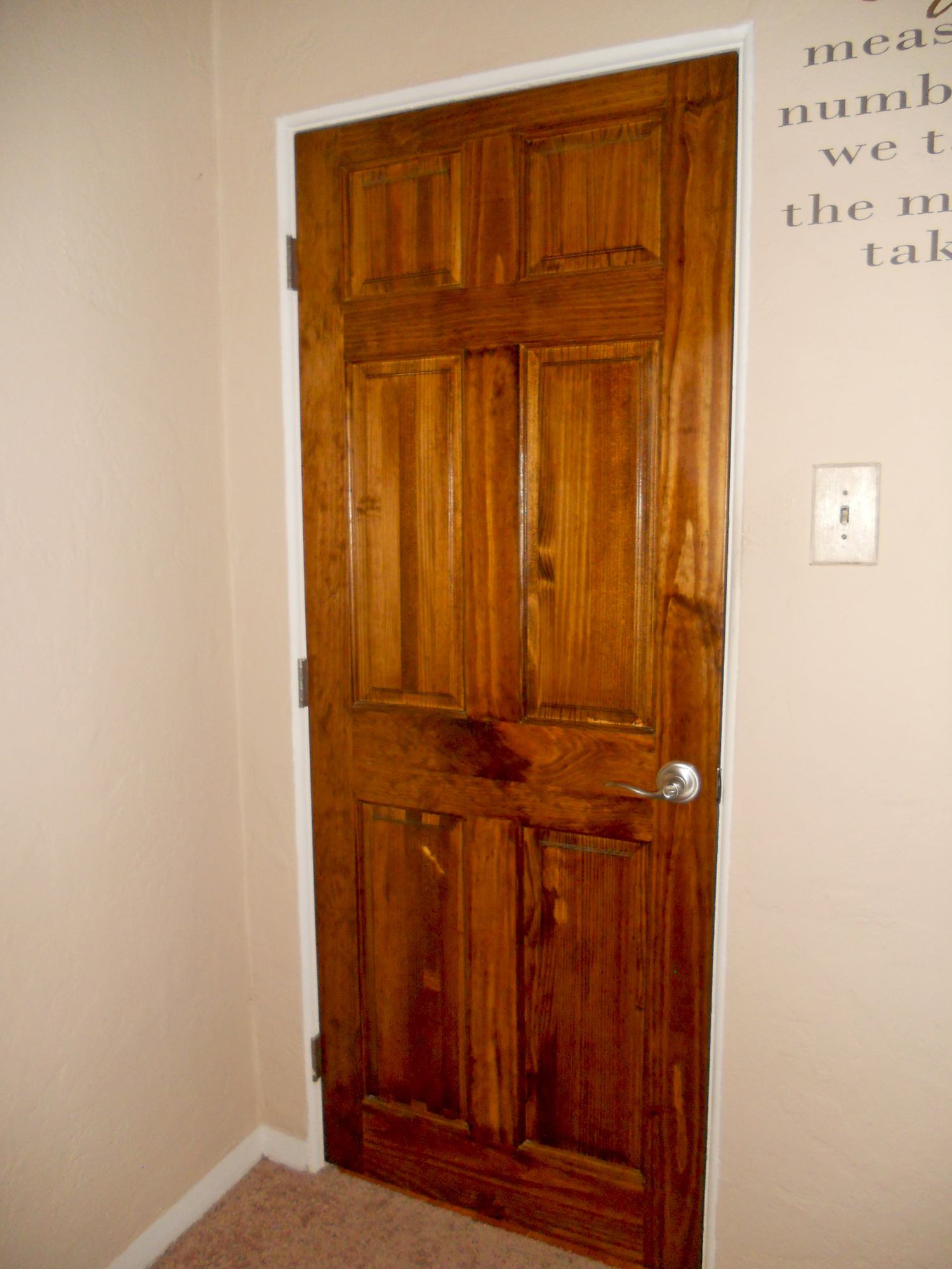 Gorgeous newer wood doors for both bedrooms and the bathroom.