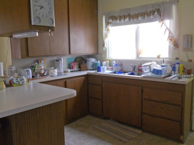 The kitchen was obviously remodeled in the 1970s; however, there is plenty of room, including a pantry and a nook area, that could easily be transformed into a modern kitchen.