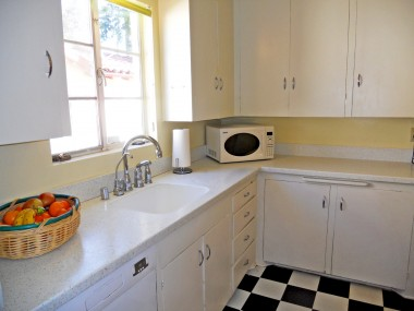 Newer Corian-like counter tops, and lots of cabinetry, and room to install more if needed.