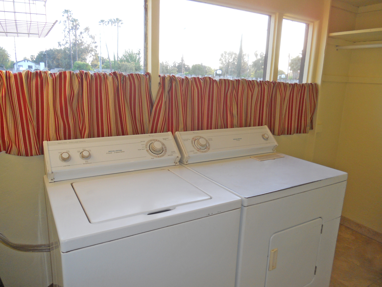 Separate indoor laundry room with amble storage space and conveniently located right off the kitchen.