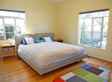 Master bedroom overlooking backyard. Crack the window for the soothing sounds of the koi pond and waterfall!