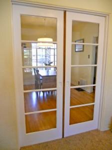 Pocket French doors separating formal dining room from bonus room.